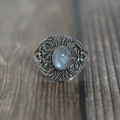 Sterling silver and Rainbow Moonstone ringRing height: 17mmRainbow Moonstone measures: 8mmSize Small (US 6 or UK L 1/2)Size Medium (US 7 or UK N 1/2)Size Large (US 8 or UK P 1/2)