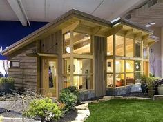 Check out the chained roof over the side porch. Love the side profile of this small home.