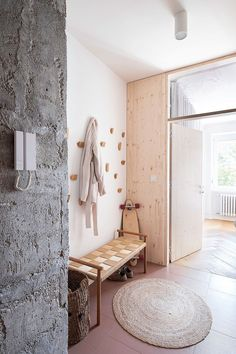 A Brutalist '60s Apartment Gets a Bright and Airy Makeover #dwell #moderndesign #interiordesign #homerenovations Concrete Column, Glass Brick, Kitchen And Bath Remodeling, Old Apartments, Modern Hallway, Oak Hardwood Flooring, Apartment Renovation, White Laminate, Austin Homes