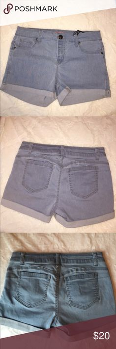 High Waisted Light Denim Shorts Never worn, new with tags. Size medium, closest to a size 26. Last picture shows true color best. These are stretchy and make your butt look great! Shorts Jean Shorts