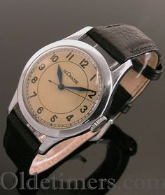 0f54a3e2e690 A round stainless steel vintage Jaeger LeCoultre watch