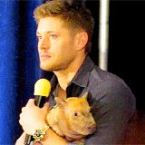 Jensen looks like ... this is my pig, and I love him, and NO ONE ELSE CAN HAVE HIM! lol