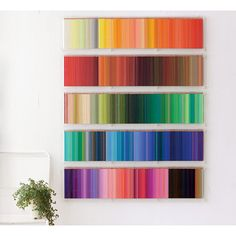 As if a piece of art, hanging on the wall for exhibition.|Hanging the 500 colour pencils on wall! Aurora display case