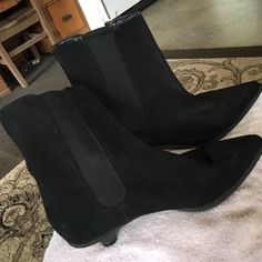 Booties - Kitten heel labeled Michael Kors Reposhing - Kitten heel suede booties with stretch panel on both sides of bootie. Labeled 'Michael Kors' on sole and inside bootie. There is no size/material label in the bootie. I'm reposhing because they don't fit me. They were posted as a size 7, which I buy in boots to allow me to wear thick socks. Even with socks they were too lose. I would say they are a 7 1/2. No zipper. They pull on and off easily. They feel comfortable. If you buy something…