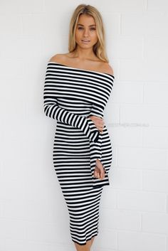 fit: standard sizing, fitted style, medium weight fabric, stretch ribbed fabric, unlined, pull on style colour: black and white stripe fabric: wool, nylon, polyester length: approx. 72cm waist to hemline our model is 163cm tall and is pictured in a size 8/S please note we suggest to go down a size, due to stretch in material.