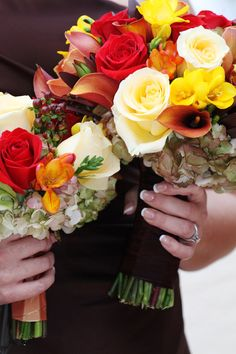 my fall wedding bridal bouquet next to one of the bridesmaids' bouquets.