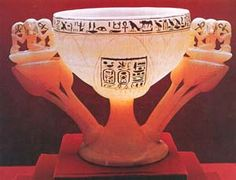 """A luminescent lotus blossom forms the bowl of this precious alabaster chalice from the tomb of King Tutankhamun, who ruled Egypt from about 1334 B.C. to 1325 B.C. Tutankhamun's name appears in the framed inscription at center. The inscription running along the cup's rim inspired its discoverers to call it the """"wishing cup"""": """" … May you spend millions of years, you who love Thebes, sitting with your face to the north wind, your two eyes beholding happiness."""""""