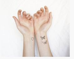 Image from http://www.kooltattooideas.com/wp-content/uploads/2014/12/Awesome-Small-Butterfly-Tattoo-On-Wrist-1.png.