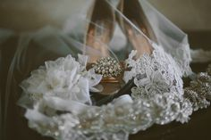Bridal accessories with elegant crystal heels & lace-embrodiered veil // johnparkerbands.com