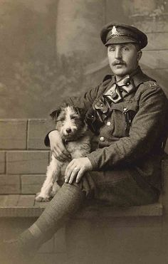 Photo of currently unknown soldier and Jack Russell Terrier.