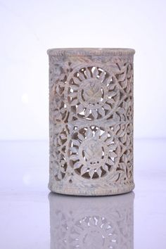 In 8 inch, 10 inch, 12 inch size.    Exquisitely hand carved small decorative ower in Gorara stone. This item is versatile, with many uses. Can be used as a flower vase. It can also be used as a perfume diffuser in rooms, offices and bathrooms. It can also be used as a tealight holder.     The 8 inch one can be used as a pen or pencil holder, a flower vase for dry or synthetic flower arrangement, a tealight or candle holder, or a perfume dispenser/diffuser. Can also be used as a tabletop…