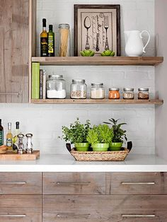 rustic kitchen cabinets and open shelves brick wall....love the color of the cabinets.