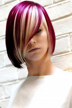 Magenta hair color with ash blonde highlights. Give your hair a rogue-like feeling with this hair color combination.