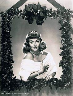 Thanks to Santa and Sidney Guilaroff, Lana Turner celebrates Christmas with Paulette Goddard's bangs. Leave some for June Allyson, Lana! [pr]