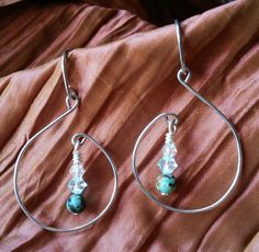 Check out this item in my Etsy shop https://www.etsy.com/listing/213930532/1-just-a-tad-loopy-dangle-shown-in