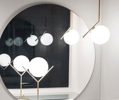 Michael Anastassiades' ceiling and table IC Light in brushed brass.