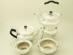 A fine and impressive antique Edwardian English sterling silver four piece tea service in the Queen Anne style; an addition to our silver teaware collection  http://www.acsilver.co.uk/shop/pc/Four-Piece-Silver-Tea-Service-Queen-Anne-Style-Antique-Edwardian-67p4597.htm