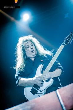 Symphony X. Michael Romeo  best guitarist ever, he may be large, but he is also in charge.