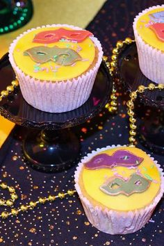 The mask cupcakes at this Mardi Gras are so cool! See more party ideas and share yours at CatchMyParty.com #catchmyparty #partyideas #mardigras #cupcakes #mardigrascupcakes  #mardigraspartyfood