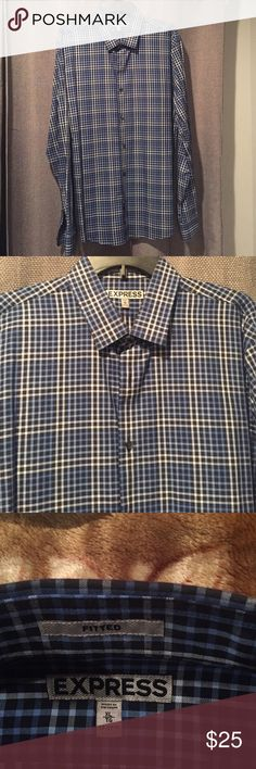 Express Fitted Long Sleeve Express Fitted Dress shirt. This blue checkered with white and black lines give it a great look for semi formal outing. Make it your own Express Shirts Casual Button Down Shirts