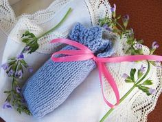 Three Eyelets Sachet - Knit this little sachet bag that starts with an easy 8-row lace edging. Filled with your favorite potpourri scents, it makes a delightful addition to your lingerie drawer or sweater shelf.