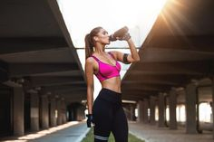 Woman in pink sports bra and black leggings holding bottle Physical Skills, Online Group, Skill Training, Pink Sports Bra, Model Release, Black Leggings, Psychology, Coaching, Sporty