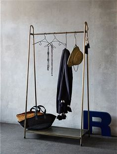 a simple ikea hack of a rigga clothes rack this metal rack is sort of institutional but now it. Black Bedroom Furniture Sets. Home Design Ideas