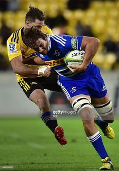Western Stormers lock Eben Etzebeth is tackled by Wellington Hurricanes winger Cory Jane during the Super 15 rugby match at Westpac Stadium in Wellington on April AFP PHOTO / MARTY MELVILLE Rugby League, Rugby Players, Eben Etzebeth, Rugby Men, April 3, Kiwi, Westerns, Crushes, War
