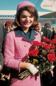 Jackie Kennedy in a pink Chanel suit, arriving in Dallas, November 22, 1963.
