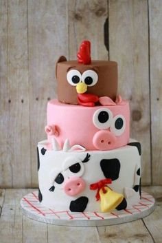Chickens, Pigs and Cows – oh my! Check out this farm animal inspired birthday ca… Chickens, Pigs and Cows – oh my! Check out this farm animal inspired birthday cake, this delicious cake is perfect for your child's Down on the Farm birthday party. Farm Animal Cakes, Farm Animal Party, Farm Animal Birthday, Barnyard Party, Farm Party, Farm Animals, Farm Birthday Cakes, Animal Cakes For Kids, Barnyard Cake
