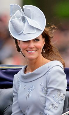 Riding about town in a horse-drawn carriage – and wearing an ice blue Jane Corbett creation atop of her perfectly coiffed yet windswept tresses – Kate cut a regal figure at the Trooping the Colour parade in 2012.