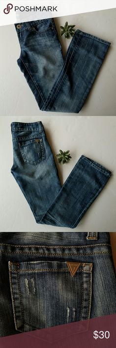 GUESS JEANS Pismo Straight Size 27 These jeans are the perfect color with the perfect amount of mild distressing (as seen on pocket). Excellent condition.  No stains, rips or tears. Smoke free pet free home.  Check out my other listings to bundle and save! Guess Jeans Straight Leg