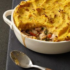 Turkey Shepherd's Pie with Two-Potato Topping | This recipe, from Jimmy Bradley of the Red Cat in New York City, makes a large pie, but you can also prepare the dish in individual 1 1/2-cup ramekins. Check them for doneness after 20 minutes.