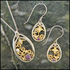 Celtic pendant and earrings in 14k white gold with 18k yellow gold trinity knot and filigree accents.  The pendant, SW4227F, is set with a 5mm round purple sapphire and two accent diamonds.  The earrings, SW4139F, are set with a pair of 2.5mm purple sapphires and accent diamonds.