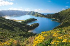 """Lagoa do Fogo, or """"Fire Lake,"""" is a gorgeous blue lake sitting in a volcanic crater rimmed by green mountains. Azores, a perfect destination for Boston travelers according Boston Globe Magazine - March 24, 2013   A four-hour direct flight from Boston brings you to this string of volcanic islands, and transports you to an altogether other world. By Neil Swidey"""
