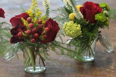 small vases of roses, berries, yarrow, air fern,  mums, and I can't remember the white flower-these are colorful =)