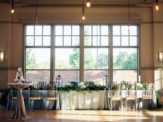 Noah's Lincolnshire Event Center // Chicago wedding venue, Chicago Suburb Wedding Venue, Edison Lightbulbs, Blue Wedding, Head Table, Feasting Table, Tablescape, Garland, Greenery, Wedding Cake  Sweetchic Events, Chicago Wedding Planner, Chicago Wedding, Noah's Lincolnshire Wedding