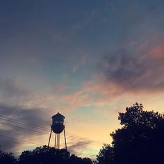 I love the sky in this photo, With the dark contrast of the tree's also including,The Gruene water tower which stands guard over the town on a bluff above the Guadalupe River.😍😍 _______________________________________________________ #perfect #detail #focused #focus #upclose #informitive #flowers #texas #tower #gruene  #picoftheday #photography #photographer #motovation #background #beautiful #like4like #followforfollow #image #gains #gains💪 #adventure #trippy #contrast #tbh #sunset…