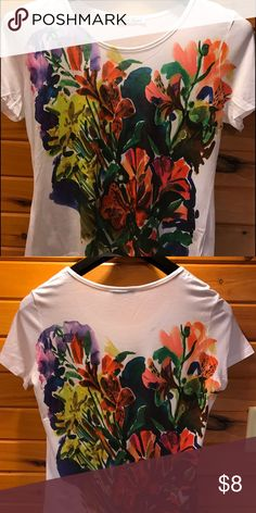 NWOT. Print short sleeve shirt Floral print front and back.  Never worn. Tops Tees - Short Sleeve