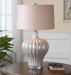 Ribbed Ceramic Base Finished In An Iridescent Pearl Glaze Accented With A Crystal Foot. The Round Hardback Drum Shade Is A Khaki Linen Fabric With Natural Slubbing. Due To The Nature Of Fired Glazes O