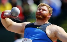 American shot putter Kurtis Roberts huffs and puffs as he exerts himself during the U.S. Olympic athletics trials in Eugene, Oregon, on June 23, 2012.