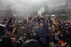 Doug Marrone holds up the Pinstripe Bowl trophy in a ceremony after the game. Syracuse dominates West Virginia on the ground to win Pinstripe Bowl for 2nd time in 3 years. Andrew Renneisen | Staff Photographer.
