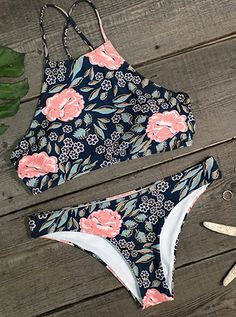 Just relax and let the beauty of this super cute bikini set wash over you.This swimsuit features the very popular high neck design with cut-in arms and floral printing and matching bottom. Just take this and enjoy your beach weekend!