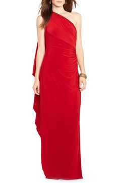 Free shipping and returns on Lauren Ralph Lauren One-Shoulder Jersey Gown at Nordstrom.com. Expert draping creates a captivating cape-like back that moves with graceful ease on this floor-skimming gown. A one-shoulder neck and ruched bodice offer a flattering fit, while a side leg slit adds to the alluring charm.