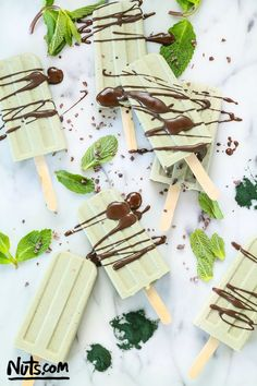 Made with coconut cream, cacao powder, cacao nibs, and other healthy ingredients, these frozen treats are 100% natural.  | Easy Summer Homemade Popsicles Recipe @purefiji