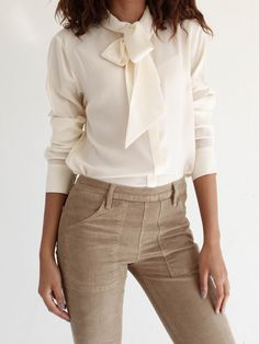 A ladylike blouse works with everything from wide leg trousers to your favorite jeans