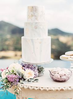 Delicate Pastel Flowers with a Watercolor Wedding Cake with Gold Foil | Sally Pinera Photography | Hey Wedding Lady Picks for a Fabulous 2016 Wedding! - http://heyweddinglady.com/hey-wedding-ladys-picks-fabulous-2016-wedding/
