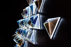 Flat-glass triangles with facets.  The composition of colours includes metallic gold, silver, and azure violet. Light up with LED. Design by Martin Lukačka