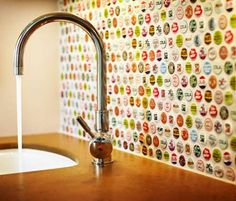 This bottle cap backsplash would go so great with my beer label decoupaged countertop!