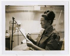 Diane Kay Corcoran working in an operating room at the 24th Evacuation Hospital in Long Binh, Vietnam, ca. 1970. Visible on her uniform are the Army Nurse Corps insignia and the U.S. Army Vietnam military patch.